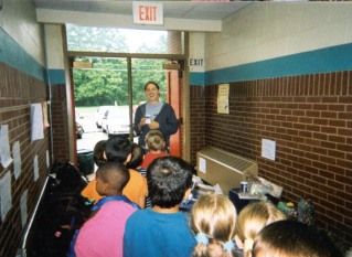 Emily Lewis educates students, 2002-2003